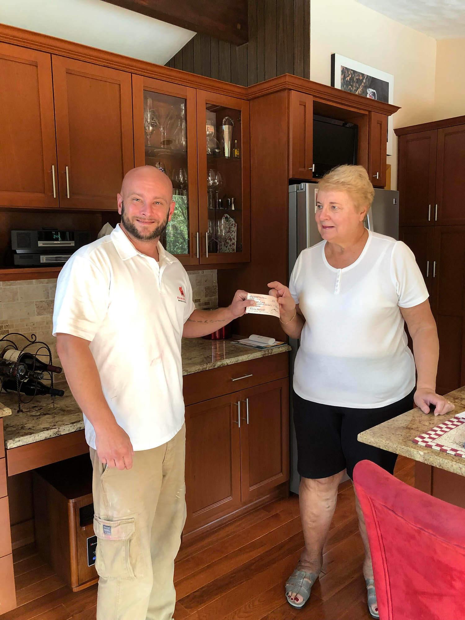 Home Repair, LLC Representative with Property Owner
